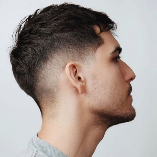 man with french crop and fade