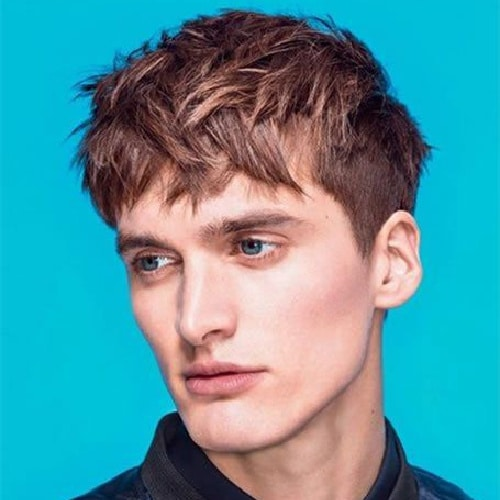model with short sides and longer hair on top