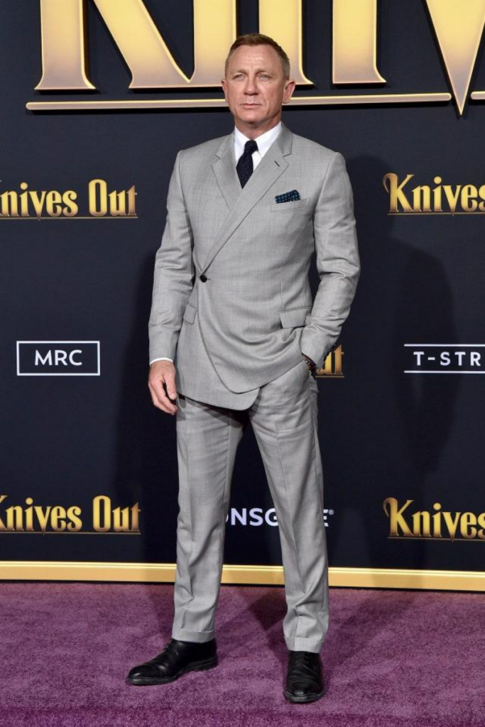 daniel craig in grey suit and chelsea boots
