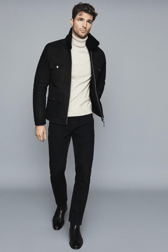 model wearing roll neck and chelsea boots