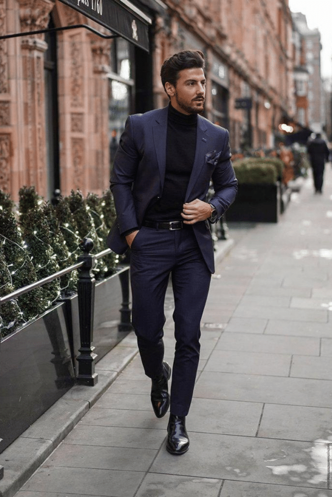 navy suit worn with chelsea boots