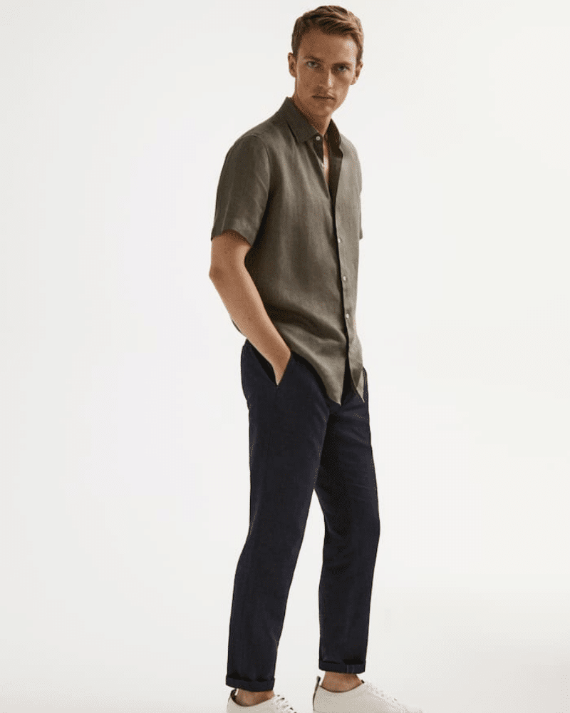 model wearing linen shirt and chinos