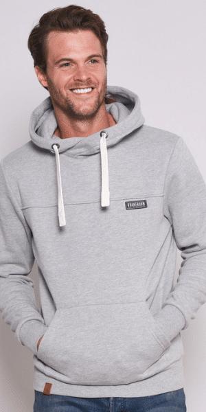 smiling model in cowl neck jumper
