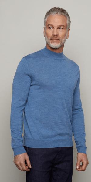 model in blue mock neck jumper