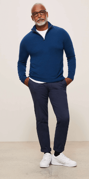 model in blue zip jumper