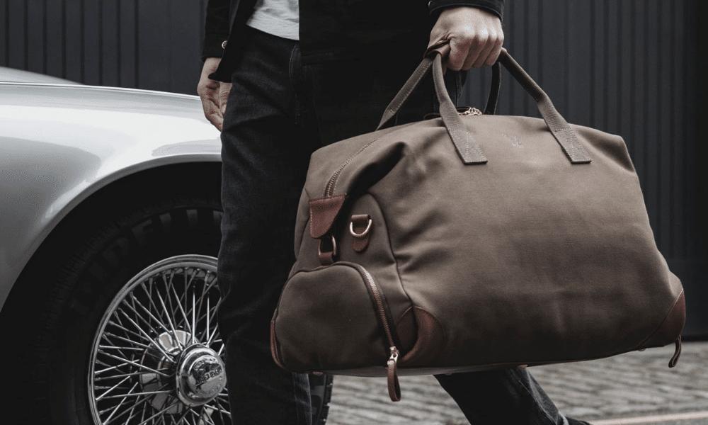 man walking with weekend bag