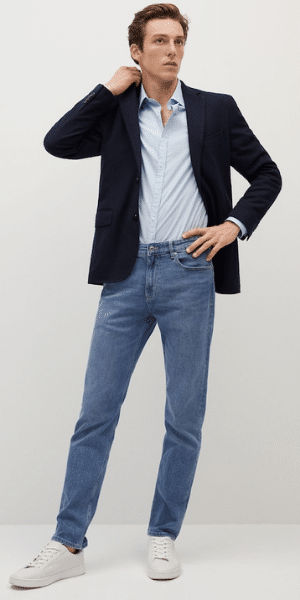 model wearing navy blazer and jeans