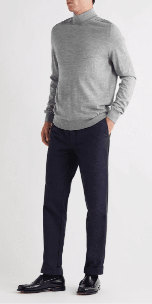 model in grey mock neck jumper
