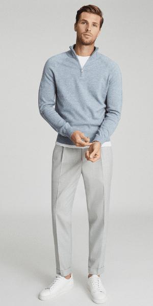 model wearing blue zip funnel top