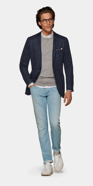 model in jeans and blazer