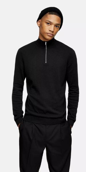 man wearing black zip neck