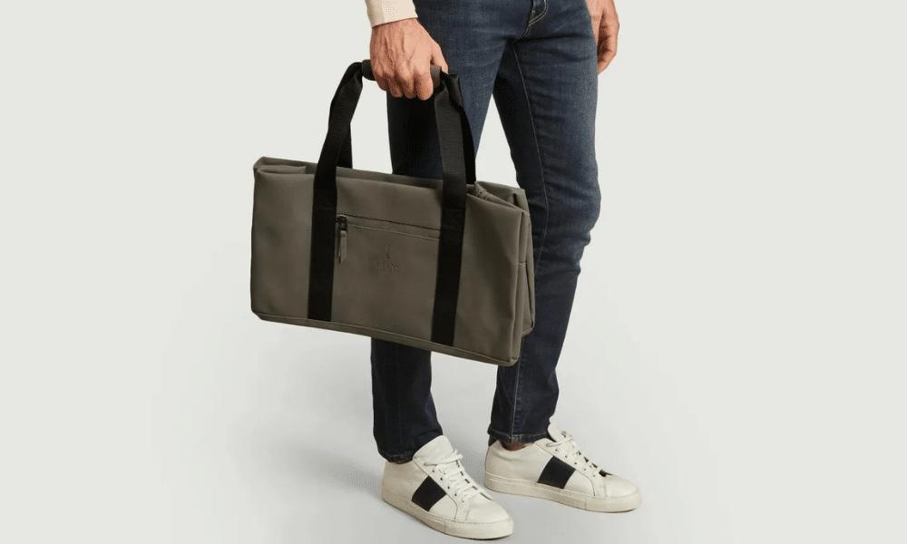 model holding gym bag