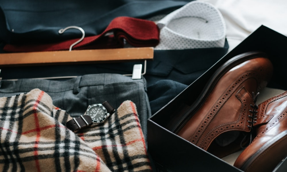 clothing and accessories on a bed