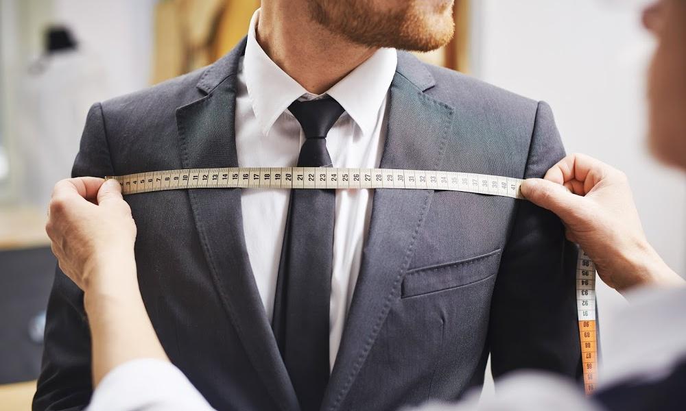 tailor measuring a business suit